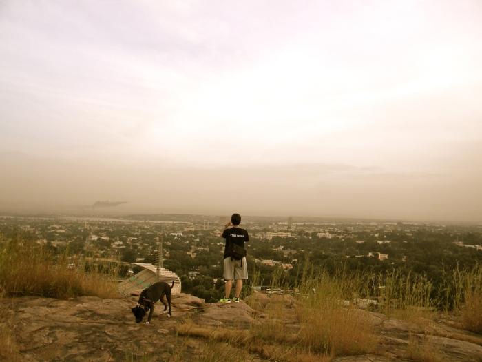 Bamako Mali national park vista cliff view dog woman