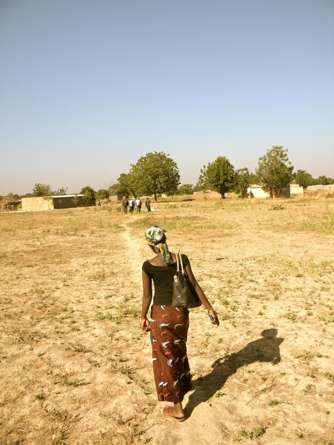 Mali rural village woman path walk