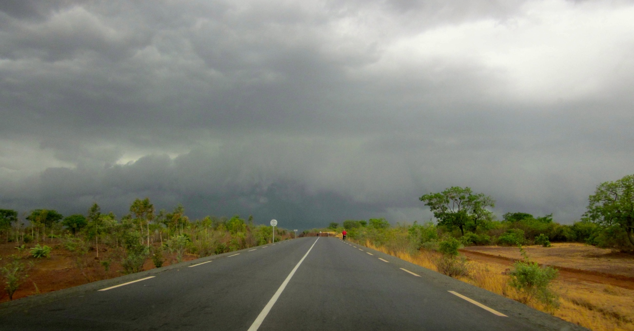 Mali rural road storm cloud grey sky rain drought