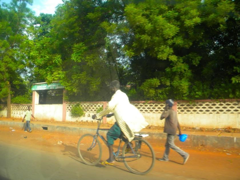 Bamako Mali bicycle man street urban city transportation commute