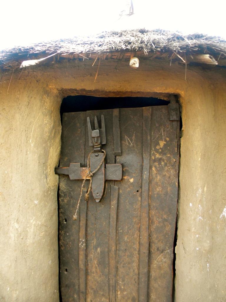 Mali village rural traditional hut design detail door wood carving