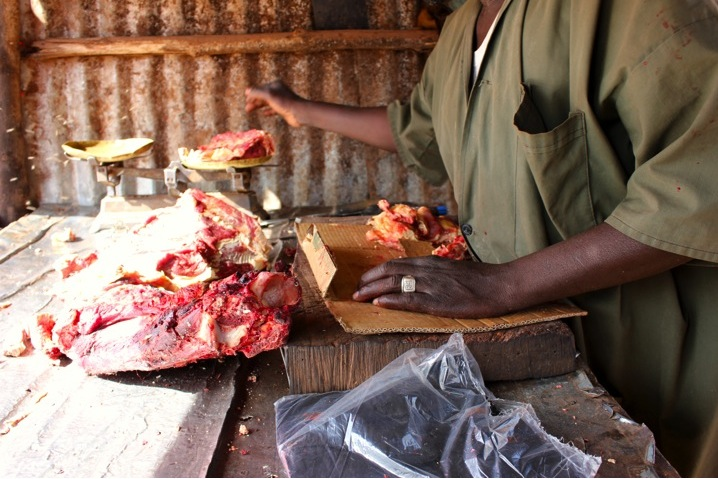 Mali Bamako urban butcher goat beef man meat raw