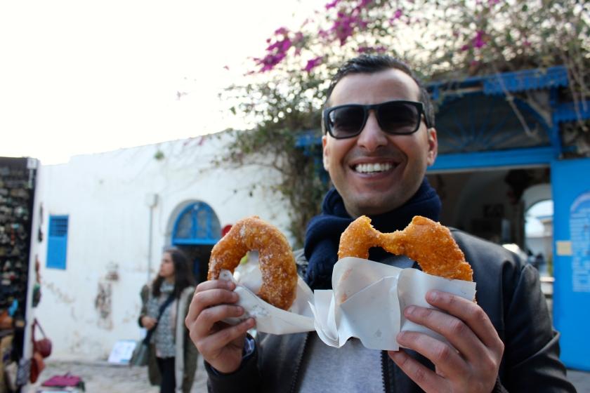 Tunis Tunisia man eat bomboloni bombalouni donut smile