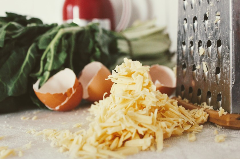 spinach egg shell shredded cheese grater counter